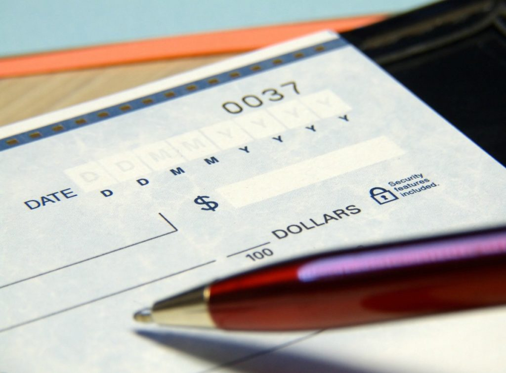 Writing A Check For A Home Deposit
